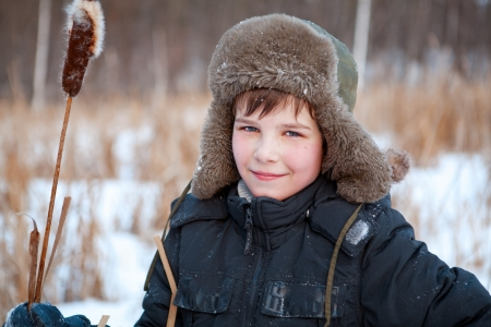 Portrait of boy wearing  hat, sedge, winter, walk photo