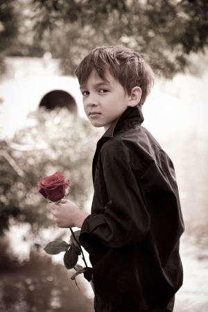 Boy with rose in his hand photo