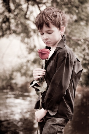 Boy with rose in his hands photo