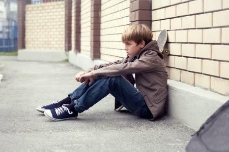 School teen with schollbag and skateboard, day Standard-Bild
