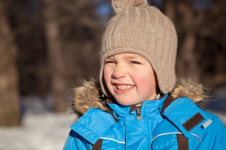 squint: boy squinted at sun, winter, park Stock Photo