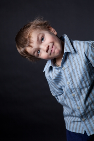 Portrait of gay boy in the studio on black background Stock Photo