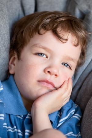 Portrait of curly sad nice boy Stock Photo - 15036989