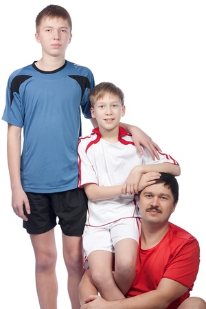 Father and two sons in sport form, isolation photo