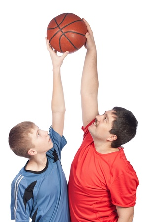 Father and son playing basketball, isolation 免版税图像
