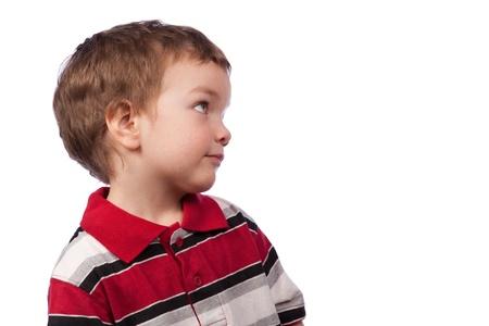Portrait eines kleinen Jungen, Profil, isoliert Lizenzfreie Bilder