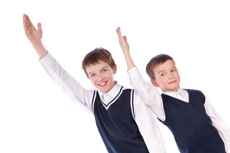 Two pupils raise their hands up, isolation photo