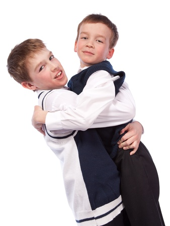 Two merry brothers hugging, isolation photo