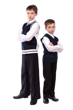 zapatos escolares: Retrato de dos hermanos en uniforme escolar, el aislamiento