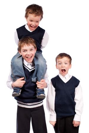 Portrait of three brothers in school uniform, isolation photo