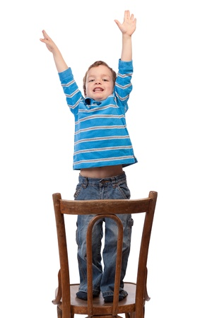 Little boy raises his arms up, isolation Stock Photo - 15067484