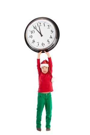 Boy in cap of Santa Claus and large clock, isolation, studio Stock Photo - 16143972