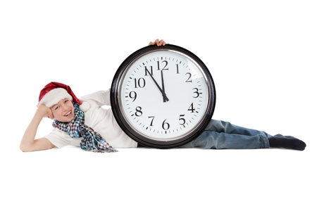 Teenager in cap of Santa Claus and large clock, isolation, studio Stock Photo - 16276320