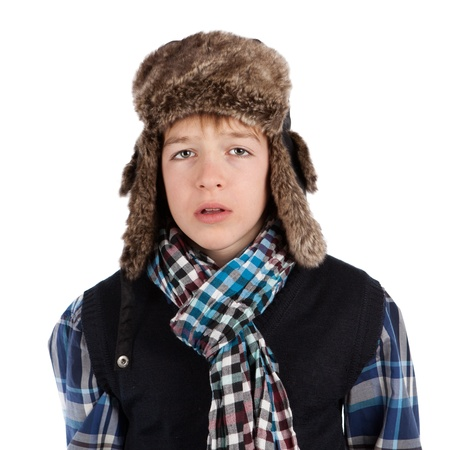 Portrait of teenager wearing fur hat, isolation photo
