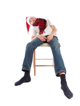 Teenager in cap of Santa Claus, isolation, studio photo