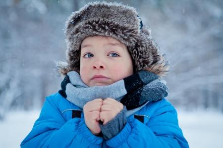 Portrait of little boy in winter time Standard-Bild