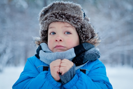 Portrait of little boy in winter time photo
