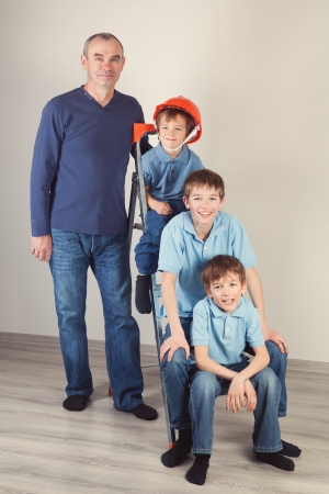 lament: Grandpa and kids on stepladder, indoor