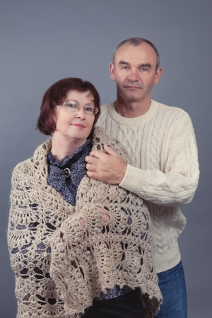 Portrait of beautiful elderly couple, studio photo