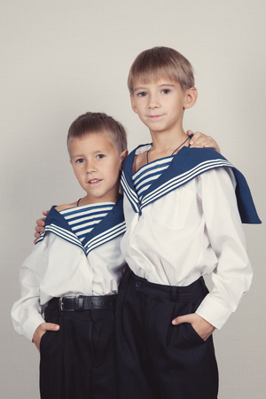 Portrait of two brothers in sailor suits, indoor photo