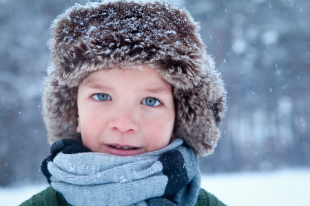 Portrait of child wearing scarf, winter photo