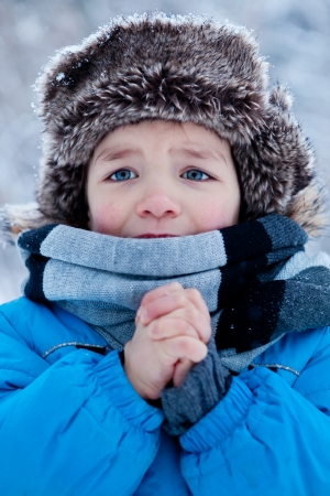 Portrait of little boy in winter time Standard-Bild