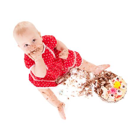 Baby Mädchen und ihr Geburtstagskuchen, Studio Lizenzfreie Bilder