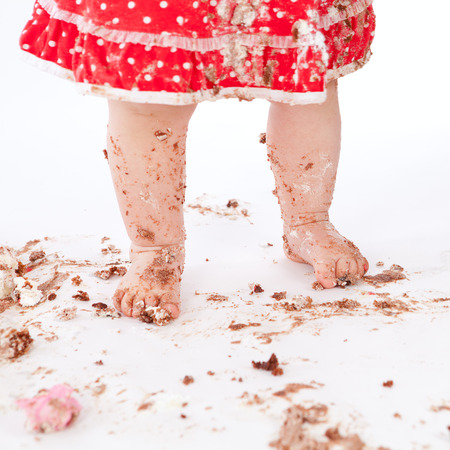 dirty baby feet on white background, studio photo