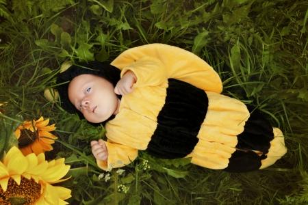 Portrait of newborn dressed as bee