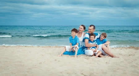 Young beautiful family with tree kids on vacation