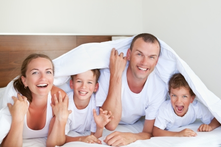 Portrait of happy and fun family in home