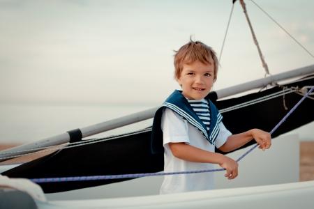 Portrait of young sailor near yacht, outdoor 免版税图像
