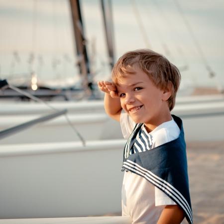 Portrait of young sailor near yacht, outdoor Standard-Bild