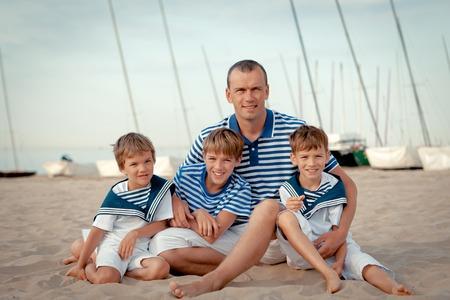 Portrait of happy family near yacht, outdoor