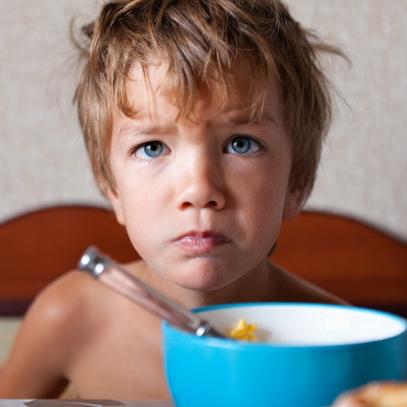 Portrait of unhappy child, not eating