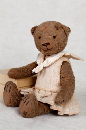 portrait of old fashioned teddy bear, handmade