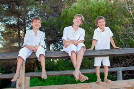 barefoot teens: Portrait of three brothers, outdoor
