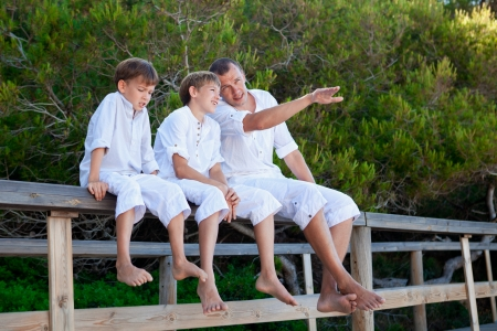 Portrait of father and three sons, outdoor photo