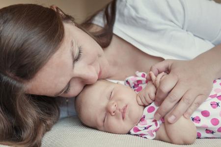 tenderness: Happy mother hugging her little daughter, baby, newborn, tenderness and love, indoor