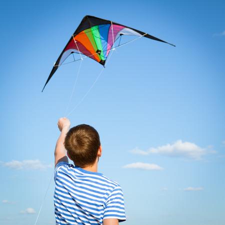joy teen flies kite into blue sky, outdoor, summer
