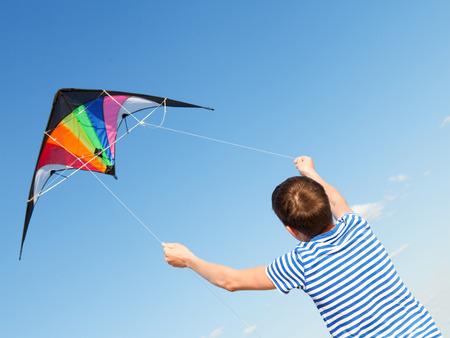 joy teen flies kite into blue sky, outdoor, summer