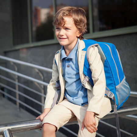 Portrait of happy schoolboy with  backpack, outdoor