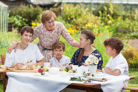 Most beautiful happy family in summer garden, portrait of two generations, grandparents with grandchildren, outdoor photo