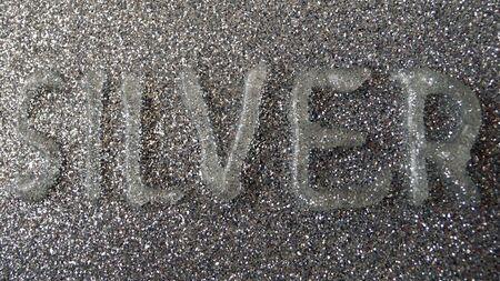 Silver writen on a silvery surface