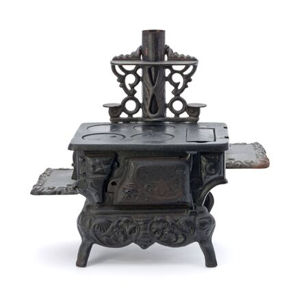 stove: Old Miniature Stove isolated on a white background