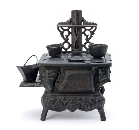 Old Miniature Stove isolated on a white background photo
