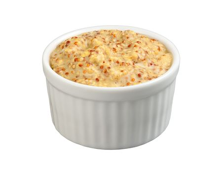 Dijon Mustard in a ramekin isolated with a path