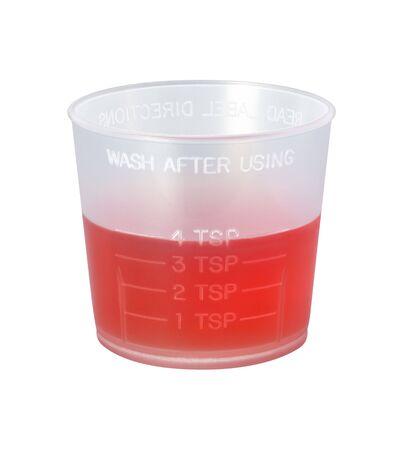Hoest Syrup Medicine Cup geïsoleerd op witte achtergrond Stockfoto