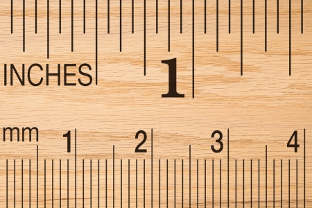 Close up of a wood ruler showing a one inch measurement.