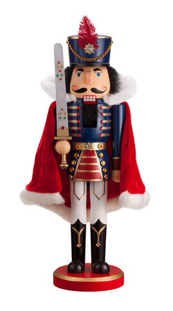 wood figurine: Nutcracker with a Cape isolated on white.